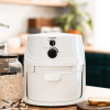 NutriMill Classic grain mill sitting on kitchen counter next to oats