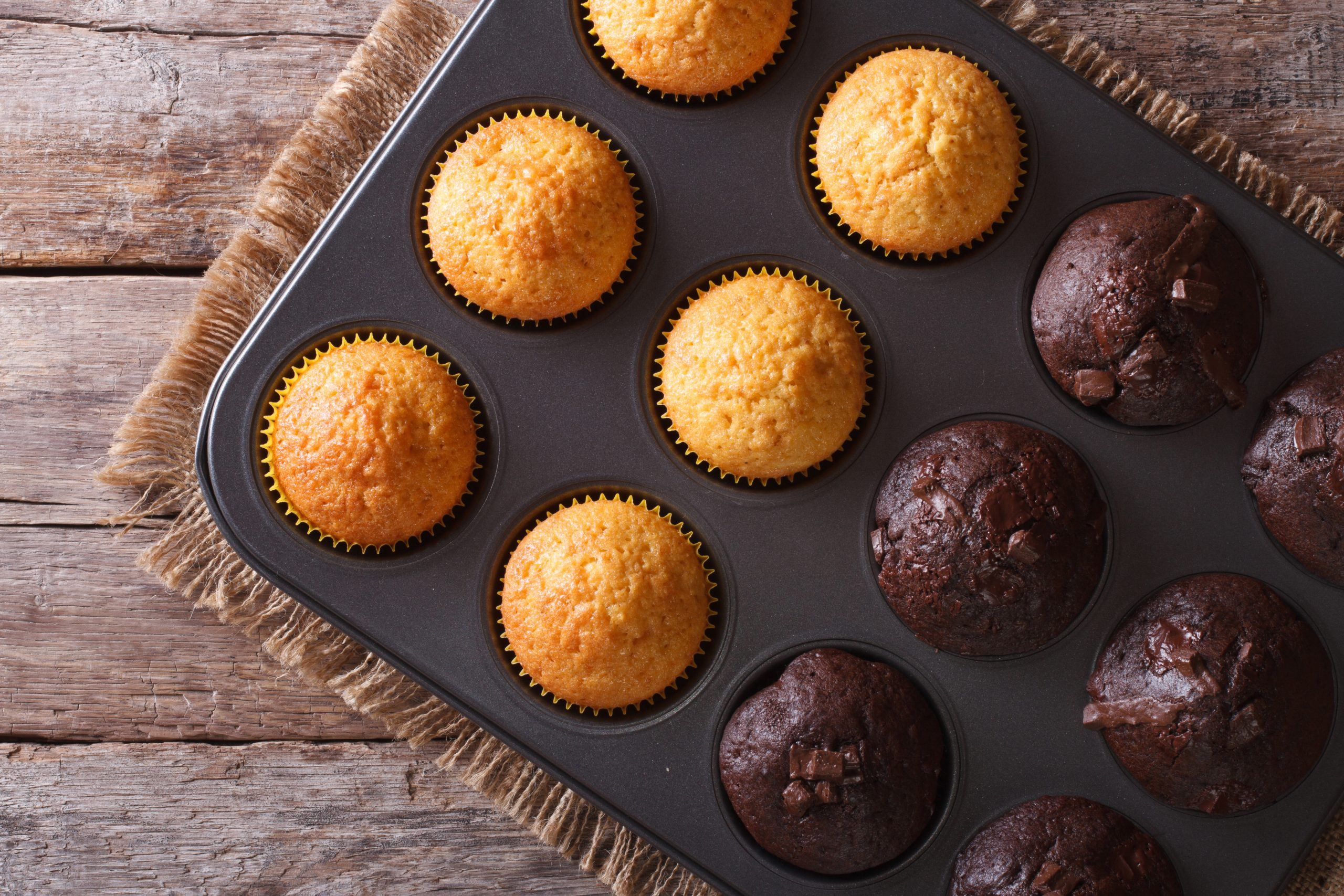 Fresh baked muffins inside of muffin tin