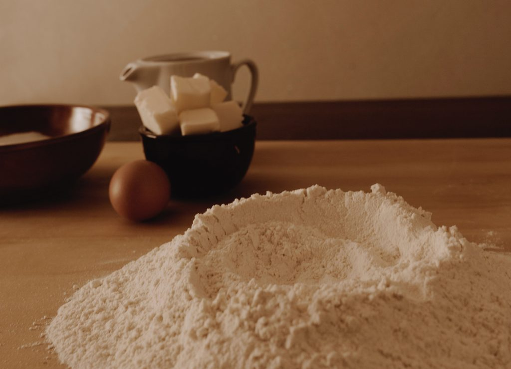 Pile of gluten free flour on a kitchen counter