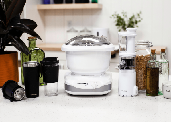 nutrimill artiste bundle mixer and juicer on counter